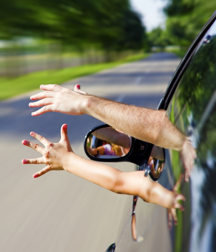 Hands waving out car window
